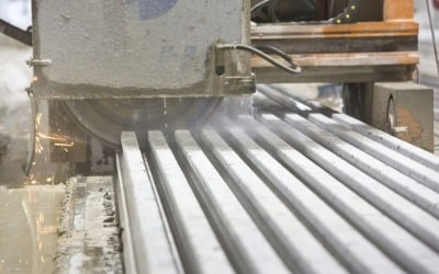 precast concrete beams cut using disc saw in factory