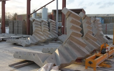 precast concrete curved staircases stacked in yard