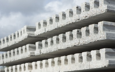 close up of precast concrete beams stacked in yard