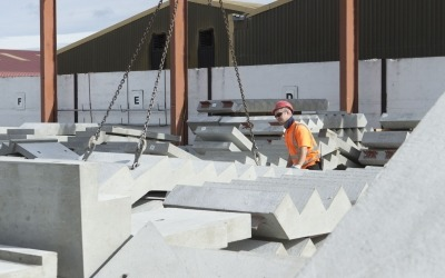 Precast concrete stairs craned into position in yard
