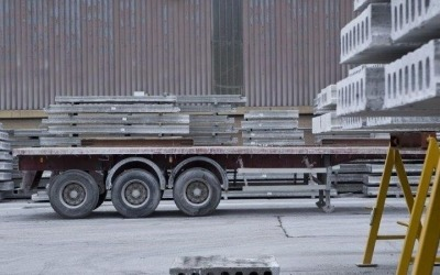 hollowcore concrete planks stacked in yard for transport