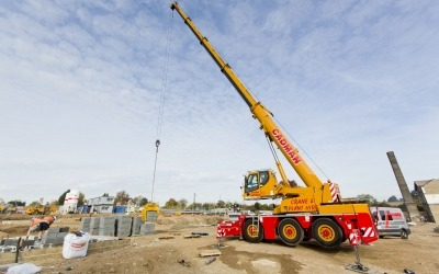 cadman crane with boom up picking concrete blocks