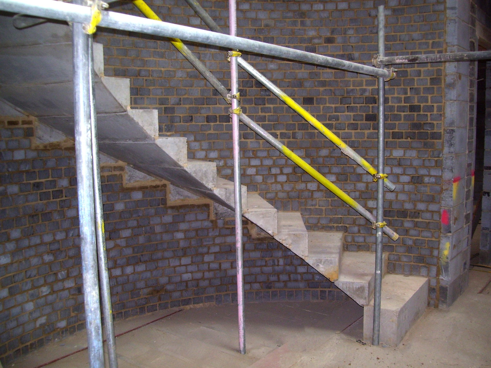 cantilever stair with scaffolding